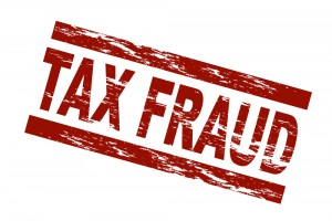 Image warning of tax fraud. Red letters spelling out tax fraud.