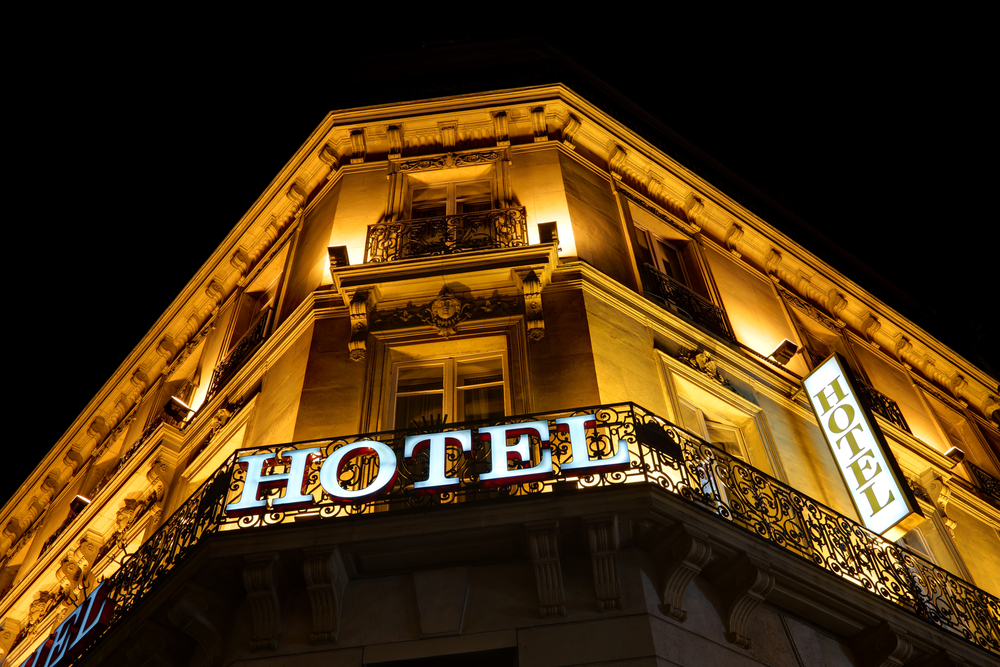 a hotel well lit at night